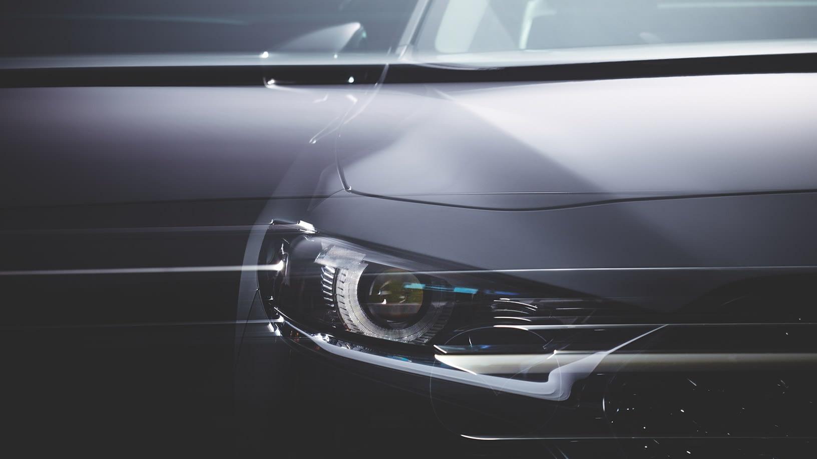Bilde av fronten av en splitter ny Mazda fra Bilservice og bilSpiten
